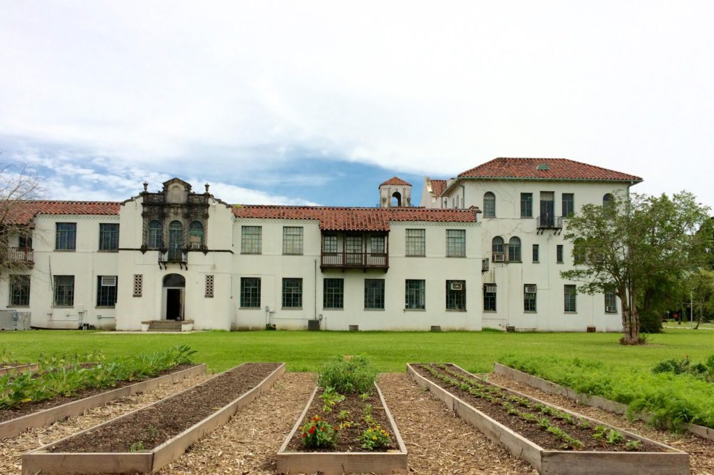 Two Acre Farms Vegetable and Herb plots at Hope Haven Center's. The 1930s historic buildings were formerly an orphanage. (Froeba)