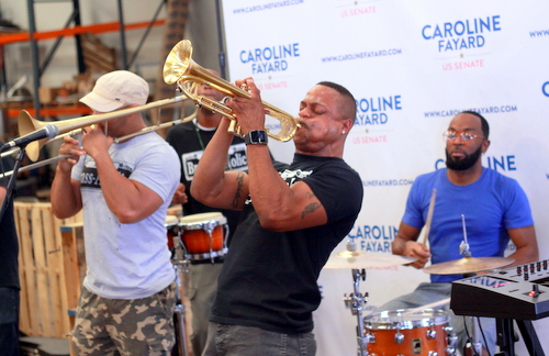 The Brass-a-holics perform at the Caroline Fayard rally.