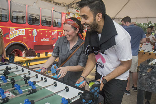 Sarah Bajor, left, and Ajay Bhoja, right, play foosball in the Classic and Vintage 3rd annual World Foosball Championship. The game was part of Freret Street Funday, a part of Tales of the Cocktail. (Zach Brien, UptownMessenger.com)