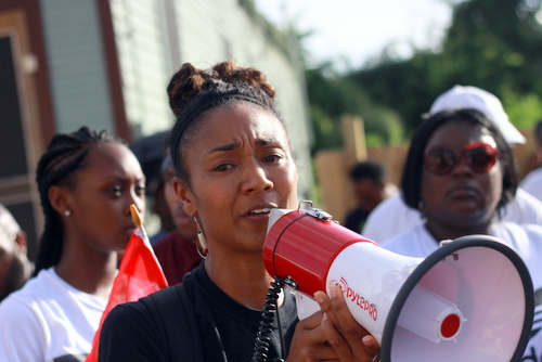 Angela Kinlaw speaks during a rally demanding justice for Eric Harris. (Robert Morris, UptownMessenger.com)
