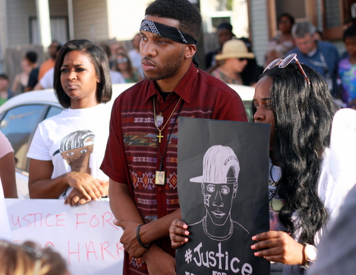 Members of Eric Harris' family listen during a rally demanding justice for Eric Harris. (Robert Morris, UptownMessenger.com)
