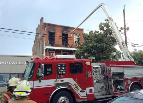 Firefighters battle a blaze at 1221 Magazine Street on Tuesday morning. (photo via New Orleans Fire Department)