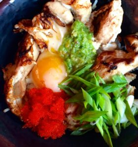 Oyakudon Rice Bowl, Japanese Chicken and Fried Egg Rice, with a Spicy Green Chili Paste, Salmon Caviar, Green Onions over Jasmin Rice. (Kristine Froeba)