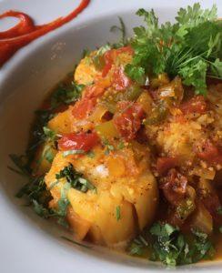 Jamaican Scalllops inpineapple juice, jalapeños, onions, bell peppers, tomatoes, and piri piri sauce (Kristine Froeba)