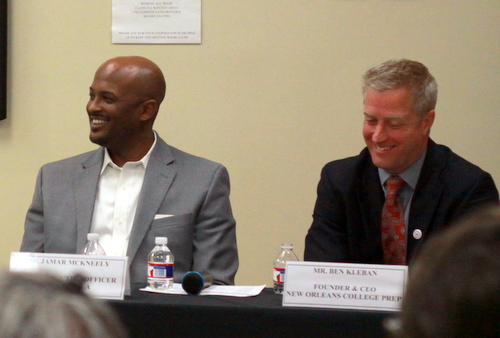 Ben Kleban (left), founder of NOLA College Prep, and Jamar McKneely, CEO of Inspire NOLA charter schools, share a laugh during an April 20 forum on school unification hosted by 100 Black Men of New Orleans. (UptownMessenger.com file photo by Robert Morris)
