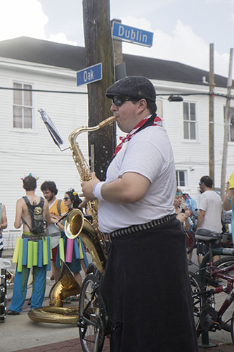 "Chris Freire of the Browncoat Brass practices his saxophone before the parade rolls. The Krewe of O.A.K. celebrated the 30th anniversary of Mid Summer Mardi Gras with the theme ""Get Wet"". (Zach Brien, UptownMessenger.com)"