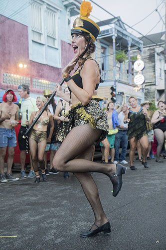 "Ali Timberlake, of Tap Dat, performs outside of the Maple Leaf Bar before the parade begins. The Krewe of O.A.K. celebrated the 30th anniversary of Mid Summer Mardi Gras with the theme ""Get Wet"". (Zach Brien, UptownMessenger.com)"