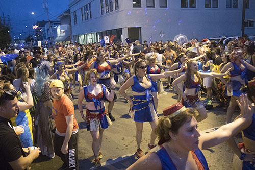 "The Organ Grinders dance their way down Oak street during Mid Summer Mardi Gras. The Krewe of O.A.K. celebrated the 30th anniversary of Mid Summer Mardi Gras with the theme ""Get Wet"". (Zach Brien, UptownMessenger.com)"