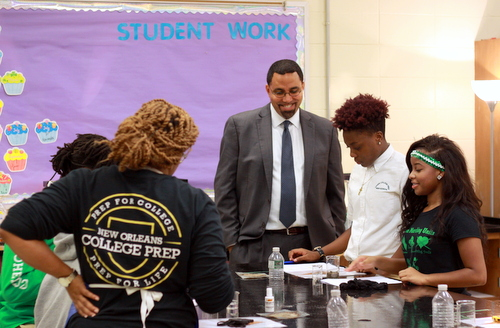 U.S. Secretary of Education John King discusses an experiment on soil samples with students Shamon Gurley and Jordyn Smith in Ariee Smith's AP Environmental Science class. (Robert Morris, UptownMessenger.com)