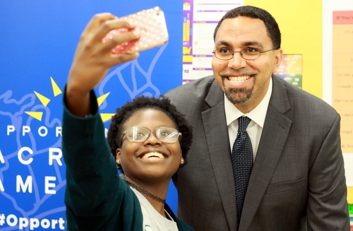 Cohen High School student Duat'e Martin poses for a selfie with U.S. Secretary of Education John King on Friday. (Robert Morris, UptownMessenger.com)