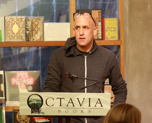 "Author Ethan Brown answers questions after reading from his new book, ""Murder in the Bayou,"" on Wednesday evening at Octavia Books. (Robert Morris, UptownMessenger.com)"