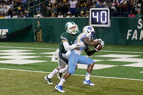 Senior defensive back Richard Allen strips the ball from Southern wide receiver Willie Quinn, forcing a touchback and a turnover. Tulane defeated Southern University 66 to 21 at their home opener at Yulman Stadium. (Zach Brien, UptownMessenger.com)