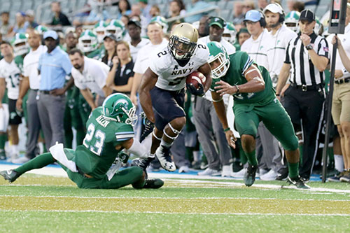 Navy running back Toneo Gulley shakes a tackle from Tulane defensive back Richard Allen. Navy defeated Tulane 21-14 at Yulman Stadium. (Zach Brien, UptownMessenger.com)