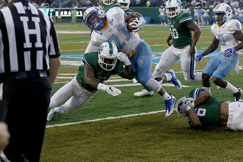 Donnie Lewis Jr., Tulane defensive back, up ends Southern running back Leonard Tillery during a run in the first quarter. Tulane defeated Southern University 66 to 21 at their home opener at Yulman Stadium. (Zach Brien, UptownMessenger.com)