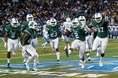 Tulane linebacker Nico Marley, center, celebrates a forced fumble in the first half. Tulane defeated Southern University 66 to 21 at their home opener at Yulman Stadium. (Zach Brien, UptownMessenger.com)