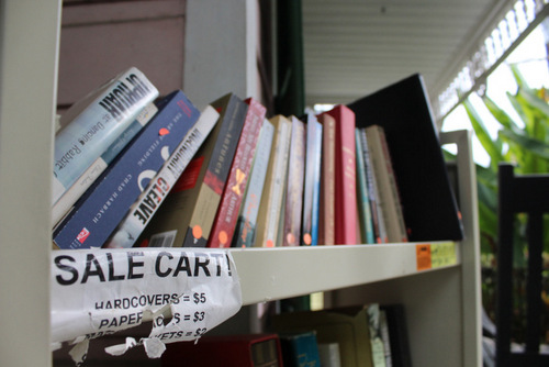 At Maple Street Book Shop, the used books that are on the shelves for too long go on the sale cart on the porch. The books sell for $2, $3 or $5. (photo by Dannielle Garcia).