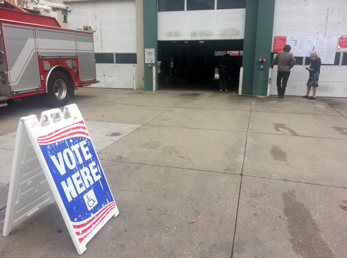 Voters study the ballot choices outside the fire station polling place on Magazine Street in the Irish Channel. (Robert Morris, UptownMessenger.com)