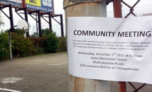 A sign at the basketball court at Pleasant and Tchoupitoulas advertises the discussion held Wednesday about the dog park. (Robert Morris, UptownMessenger.com)